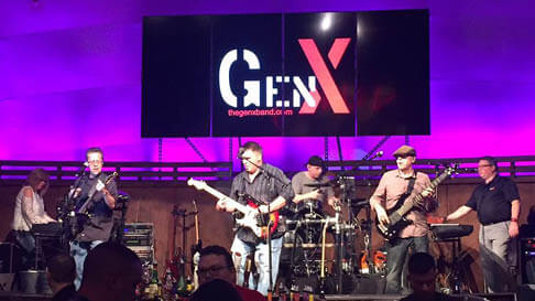 The rock band GenX performs on stage. They will play prior to Hollywood Gaming