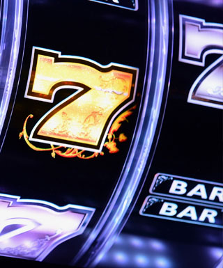 Close-up of a video poker machine showing a golden number 7 at Hollywood Casino Joliet.